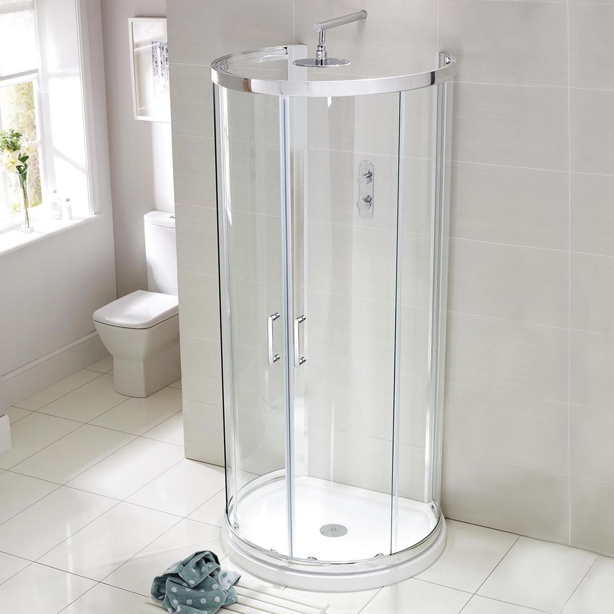 One of the smallest shower enclosures available installed against a wall