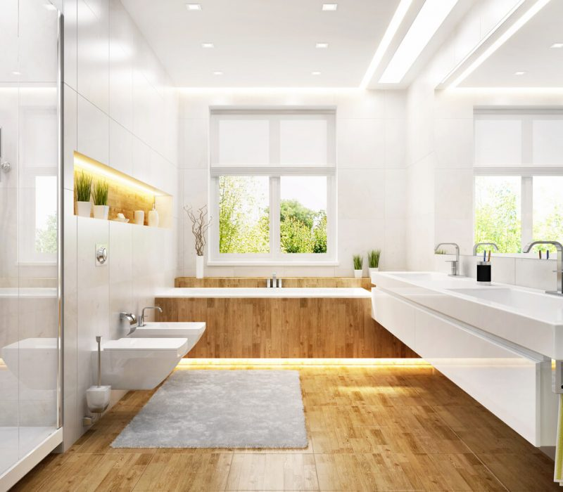 A bathroom with several lighting ideas