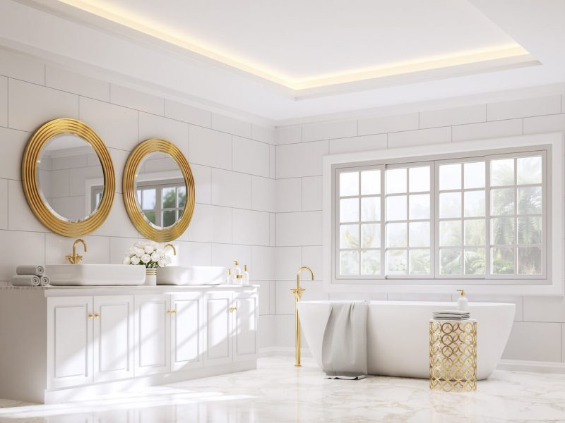 Classical style bathroom 3d render,There are white marble floor and white wall tile with brick pattern,Decorate with golden object ,Rooms have large windows, overlook terrace and nature view.