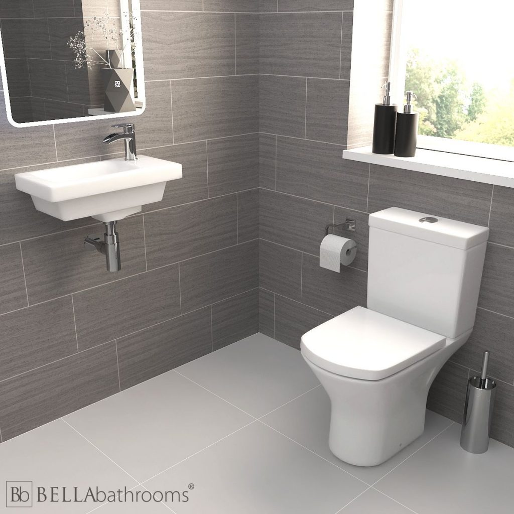 Cloakroom suite with a wall hung basin