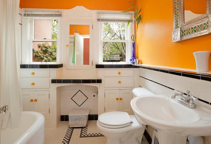 Bright orange and white colorful modern bathroom stock photo
