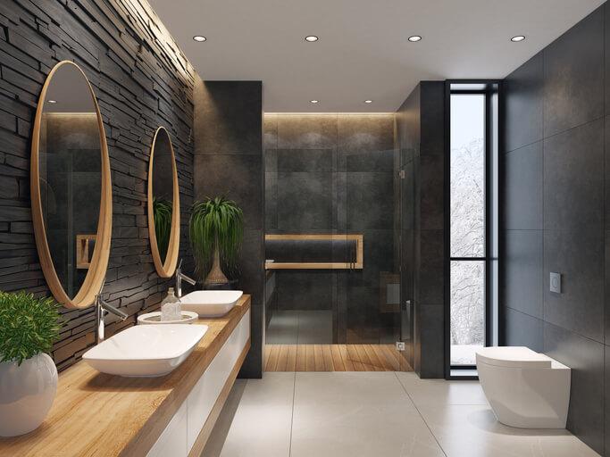 Luxurious minimalist bathroom with slate black stone wall stock photo