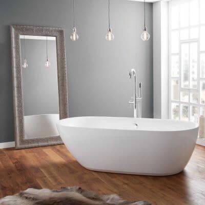 white bath tub in a bathroom