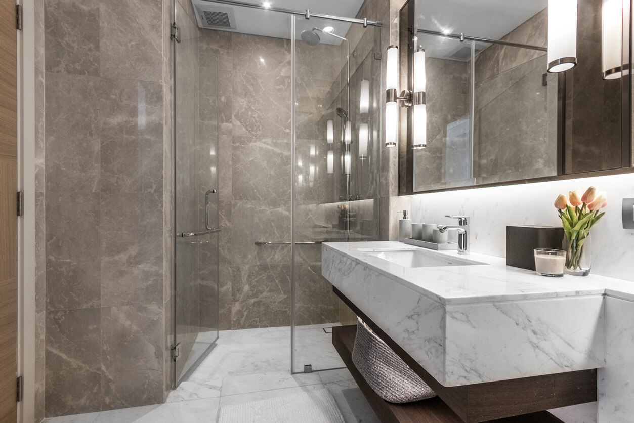 Clean and white marble bathroom with amenities