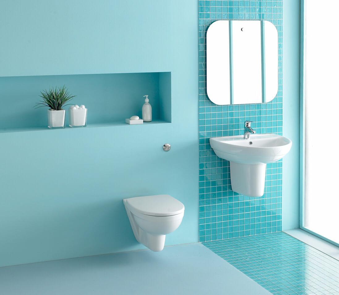 Interior of spacious bathroom in turquoise blue