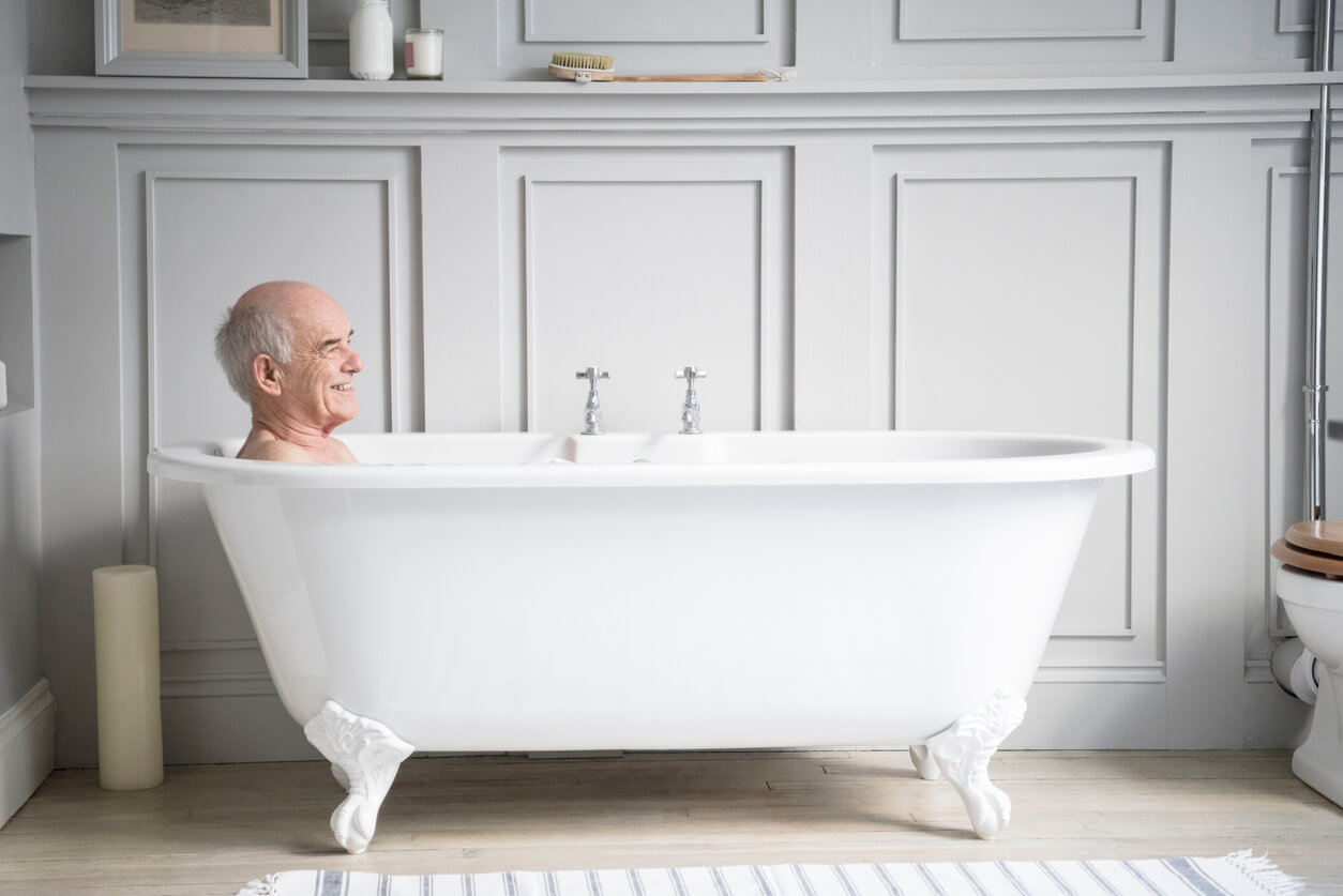 man in a two person bathtub