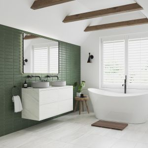 Peral bathroom furniture with a freestanding bath
