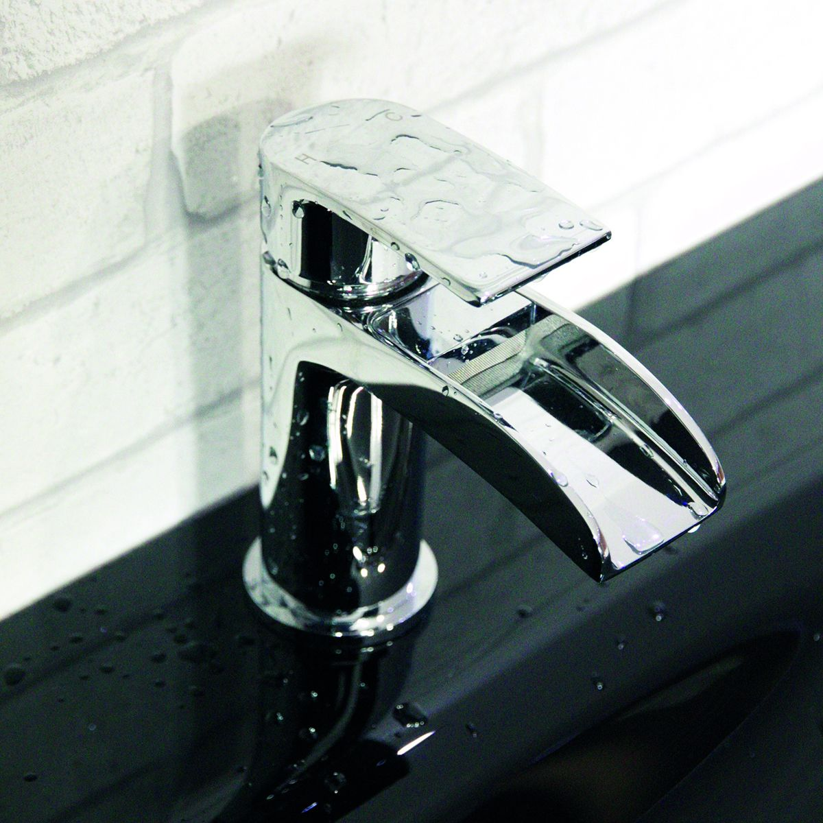 Cassellie Halton Waterfall tap installed on a basin