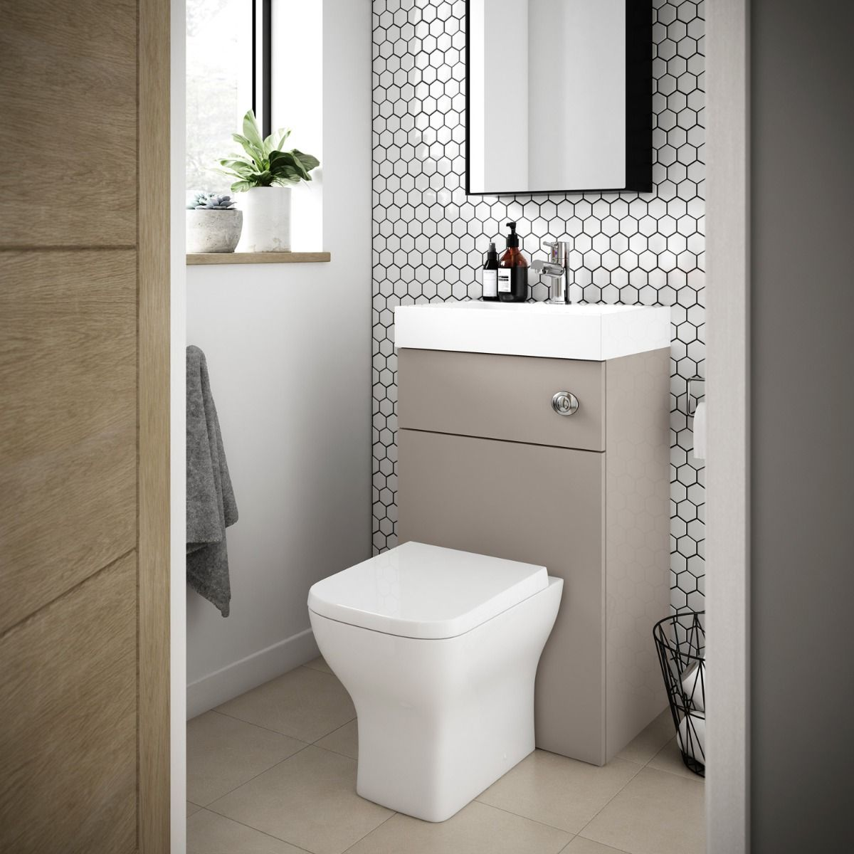 Toilet with integrated basin installed in a small room