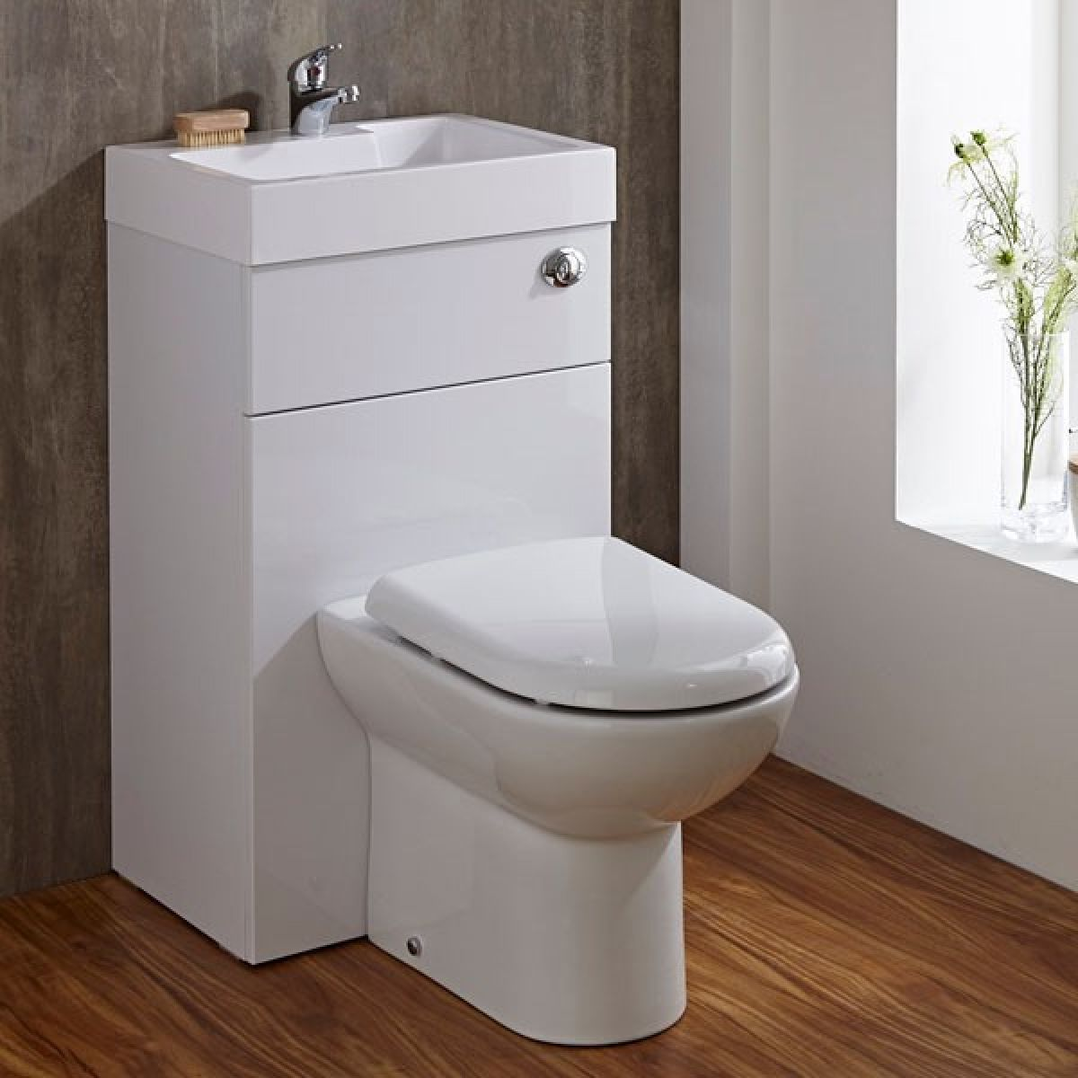 Toilet with integrated basin in room