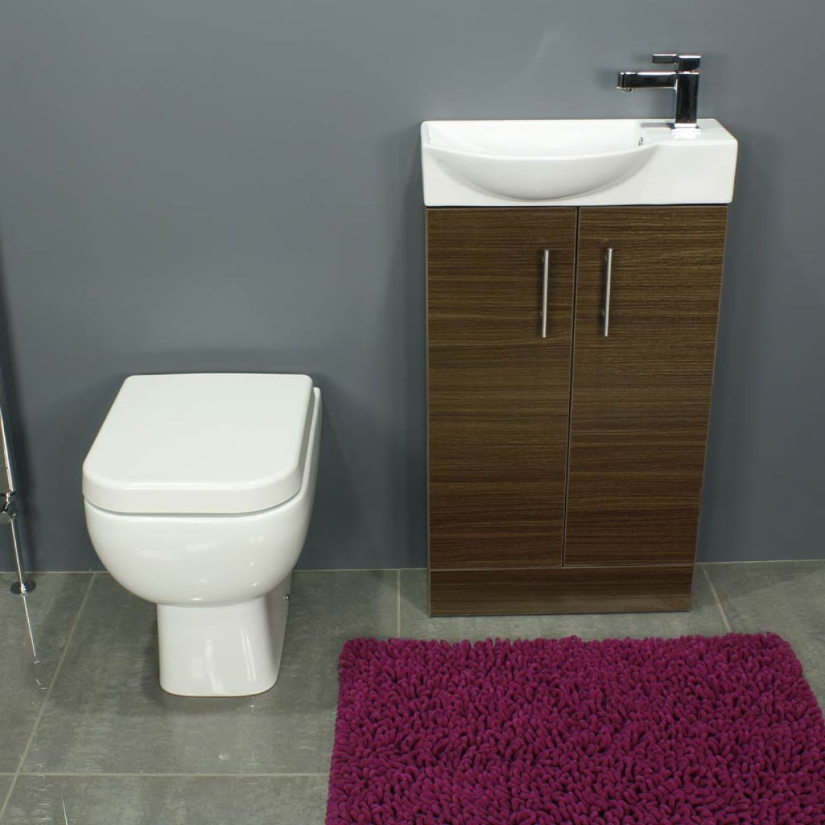 RAK Series 600 Back To Wall Toilet and 500 Series Walnut Mini Double Door Vanity Unit Front